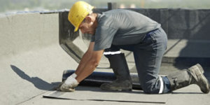 Man doing Asphalt Roofing